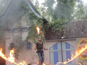 What festival would be complete without a Pyro show? At one point the bola at the end of his wire flew off into some bushes next to the stage. We were really happy that his alternative pair didn't malfunction while they were flaming and swinging toward the crowd!