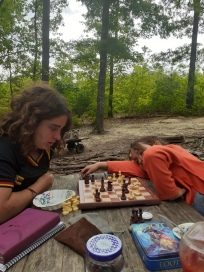 Mila and Hadassah engulfed in an intense game of chess